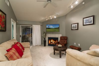 Great Living Room with vaulted ceilings, fireplace, and plenty of light.