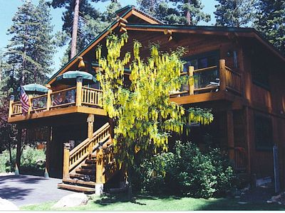 Exterior of this lovely home. The flowering tree is a golden chain tree.