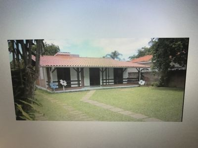 Photo for One storey house on the beach of Ponta das Canas (Florianópolis) 30 meters from the beach