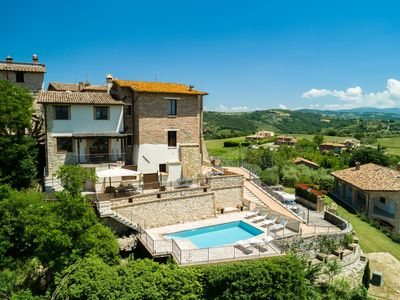 Photo for Holiday home with swimming pool and fantastic view in a special borgo