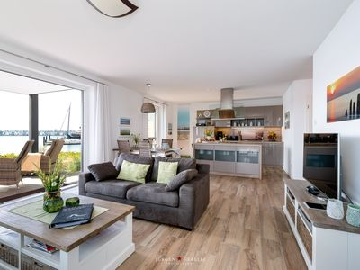Photo for Dreamlike luxury apartment right on the water with a sun terrace, sauna, fireplace