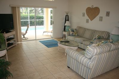 Living room with direct access to patio and pool