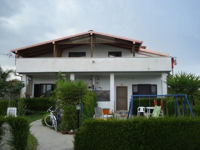 Photo for Apartment in villa with garden 300 meters from the sea