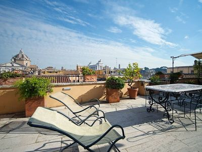 Photo for Piazza Venezia Penthouse apartment in Centro Storico with WiFi, air conditioning, private terrace, …