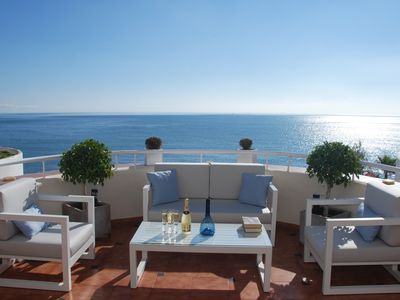 Photo for NEW LISTING. Waterfront. Stunning apartment facing the sea. Large terrace