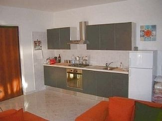 Well equipped open plan linear Kitchen