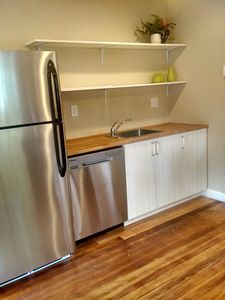 stainless steel appliances including a new dishwasher and all new cabinets