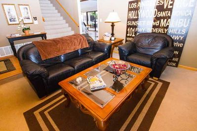 Living Room with 42' flat screen TV/DVD, games, books.