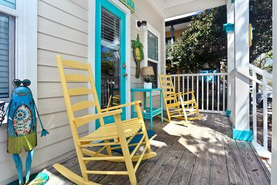 Our cool and vibrant front porch begs you to stay and rock all day and night!