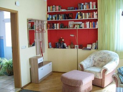 Wardrobe and bookcase with reading chair