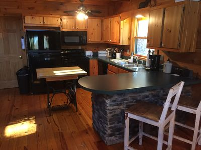 kitchen with refrigerator/freezer, range, oven, sink, coffee pot and microwave