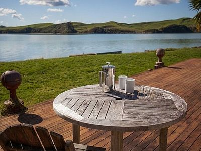Photo for Point of Difference - Waterfront Raglan Holiday Home