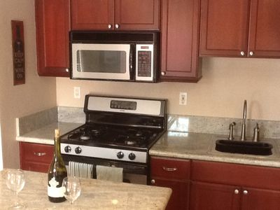 Granite counter tops throughout kitchen.