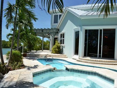 P30 - Luxury 4 bedroom 3 bath, single family home with private pool and deep water dockage.