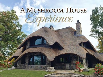 Photo for Charlevoix Mushroom Thatch House. Walk to Downtown. Beach Across the Street!
