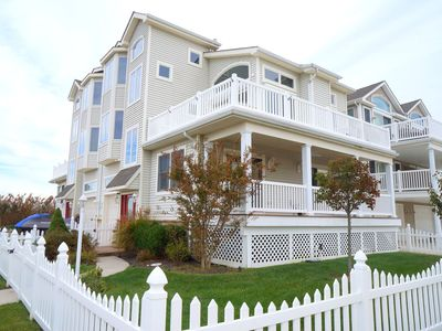 Photo for SUNSETS!!! Sit on the deck & relax in a peaceful setting - unobstructed panoramic views of the bay.