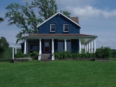 Photo for The historic Blue House on the shores of Colpoys Bay