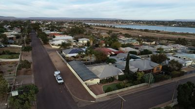 Cross Roads Traveller`s Rest Retreat with city & bridges across the Spencer Gulf