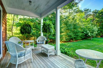 Back porch with wicker furniture