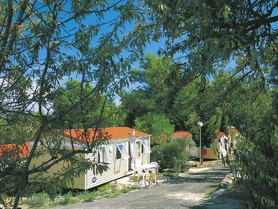 Photo for Cozy chalet with terrace in a wooded area close to Agde