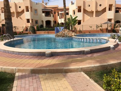 Photo for LOOK NO FURTHER ground floor apartment, with a  pool,  wifi , close to the beach