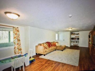 Large living room with flat screen TV