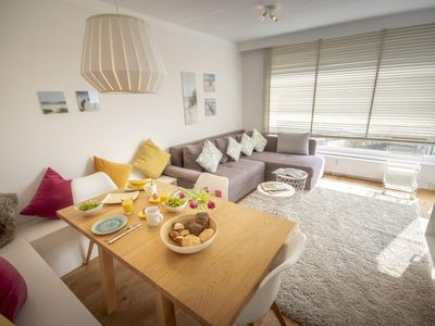 """Photo for Welcome to the pirate nest directly on the beautiful North Sea! Feel well in this new, lovingly furnished luxury apartment in the house """"Fresh breeze"""". In the light-filled apartment you are greeted by the magnificent view over the beach, the sea and the forest."""