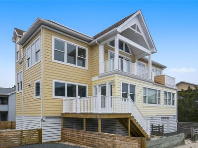 Photo for FREE ACTIVITIES INCLUDED!  Super location this 3 bedroom, 2 full bath vintage beach cottage is just one home back from the beach front with partial ocean views and easy beach access, house sits directly across from the beach walkway!