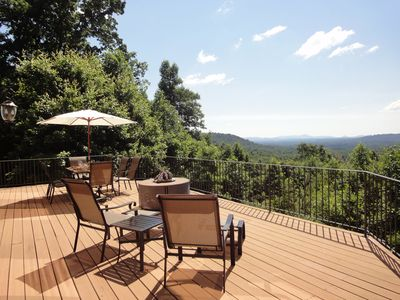 Incredible view from large deck with bronze sling furniture & gas firepit.