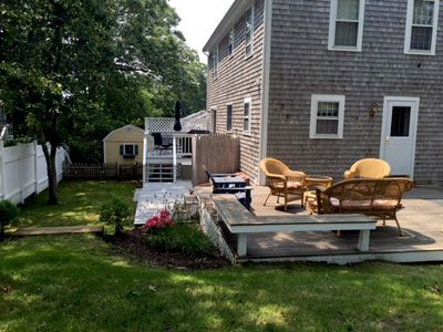 Enjoy time in the yard with a deck, outdoor dining table, and gas grill - 17 Woodbine Road Harwich Port Cape Cod New England Vacation Rentals