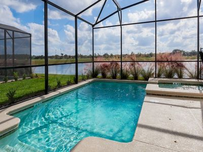Photo for STOREY LAKE LAKEFRONT SUNSETS LUXURY HOME STEPS FROM DISNEY