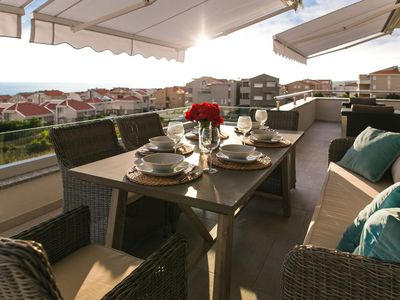 Photo for Two bedroom apartment with terrace and sea view Novalja, Pag (A-11775-b)