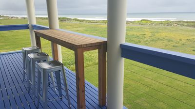 Photo for BLUE SEAS  Absolute Beach Front - Panoramic views and easy access to beach!