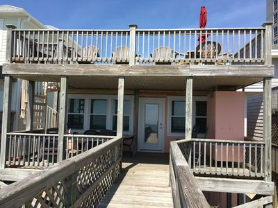 ocean side of cottage with 2 decks, total of 16 chairs & enclosed deck shower