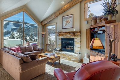 Relax in the cozy living room with outstanding views of the ski resort