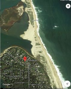 Photo for Four bedroom classic Cape cottage with tennis court steps from Nauset beach.