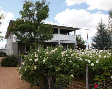 Outside of Marfa Boarding House with large rose garden in front