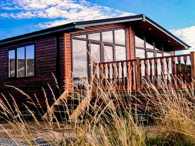 Photo for Rockhill Holiday Park. 4 bedroom luxury bay view cabin. Sleeps 9