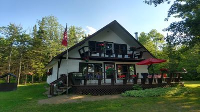 Photo for Waterfront Chalet with Mountainviews and Sandy Beach 90 Miles N of Ottawa Canada