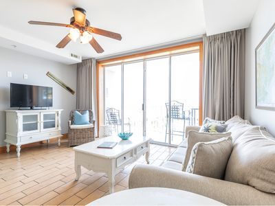Photo for Ocean Views from your living room and balcony! Beachfront Resort with Community Pools, Pet Friendly!
