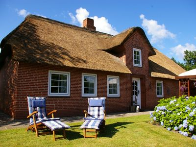 Photo for Relax in the 100-year-old thatched cottage with large garden