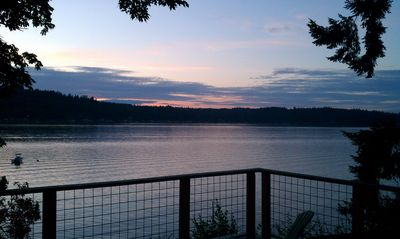 Photo for Huge new deck, spectacular views and the beach. Waterfront hideaway.