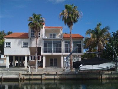 Water Front View of Home with Dock Space for a Large Boat