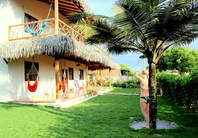 Take a fresh shower under our Palm Tree, keeping sand away from the house