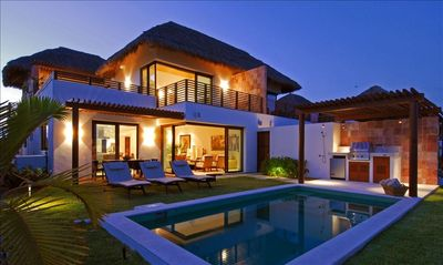 heated pool in front yard with ocean view
