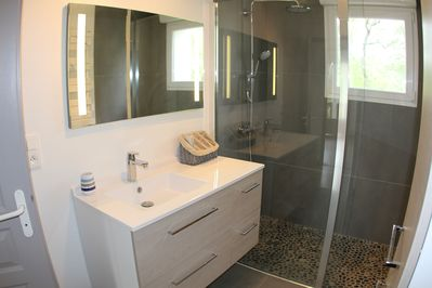 Brand new Italian bathroom, Towels dryer, view on the top trees