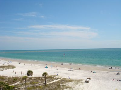 View of the beach and gulf waters from balcony looking  left.