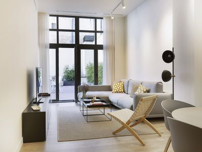 Photo for TÀPIES: New, modern and design apartment with large terrace.
