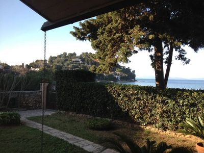 Photo for Porto Santo Stefano: Independent apartment in villa on the sea with garden, 3 bedrooms and large living room with sea view