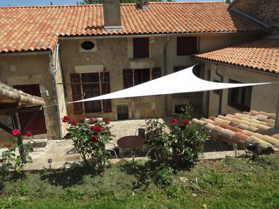Photo for Spacious charming house, completely renovated with courtyard, garden and barbecue